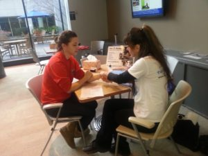 Hand massages for students at Emory in Atlanta