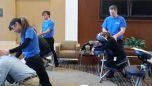 Chair Massage at work benefits employees & employers