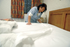 A Hardworking Housekeeper attending to a guests room.