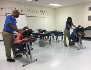 Chair Massage for Teacher Appreciation Day is a treat these teachers won't forget.